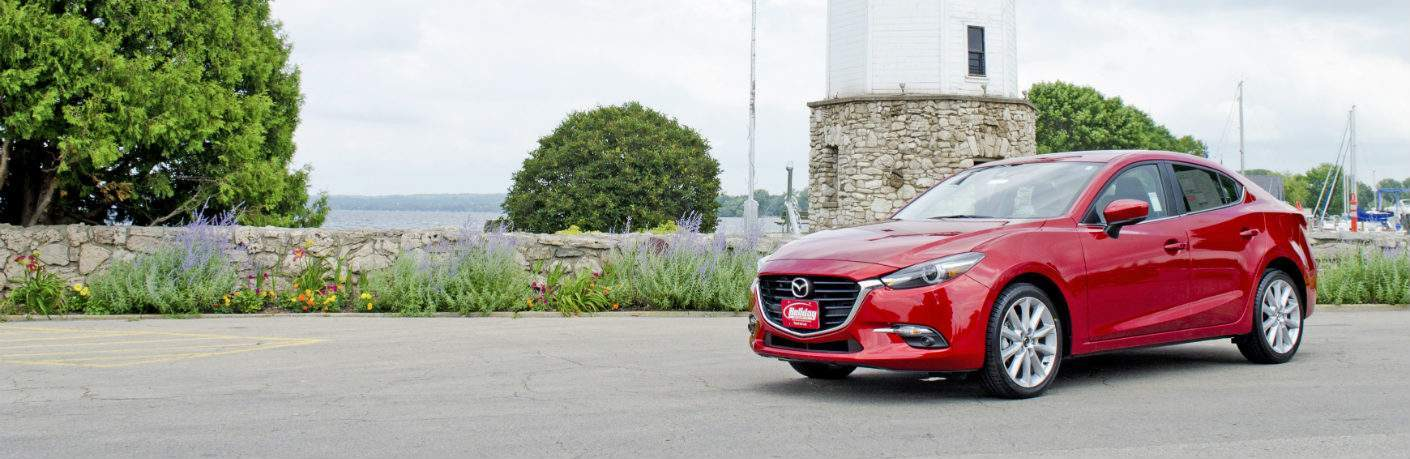 2018 Mazda3 in front of a Fond du Lac lighthouse