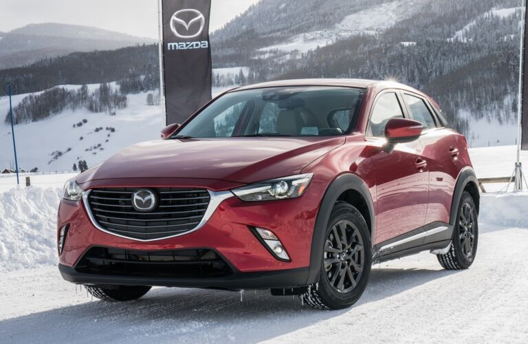 2018 Mazda CX-3 red front view in snow with AWD
