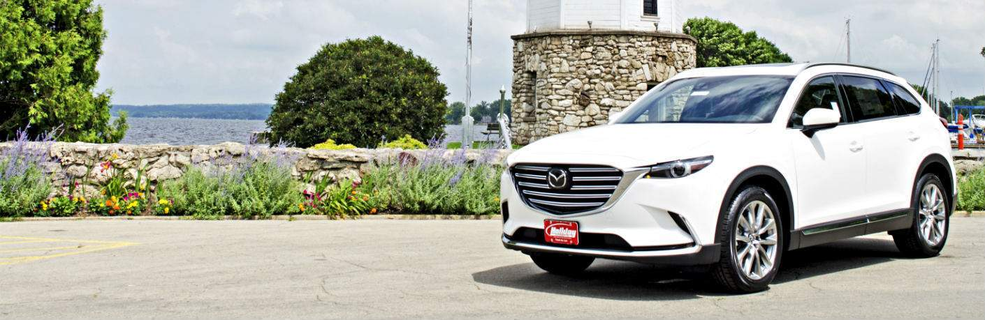 2018 Mazda CX-9 white side view in front of a lighthouse in Fond du Lac