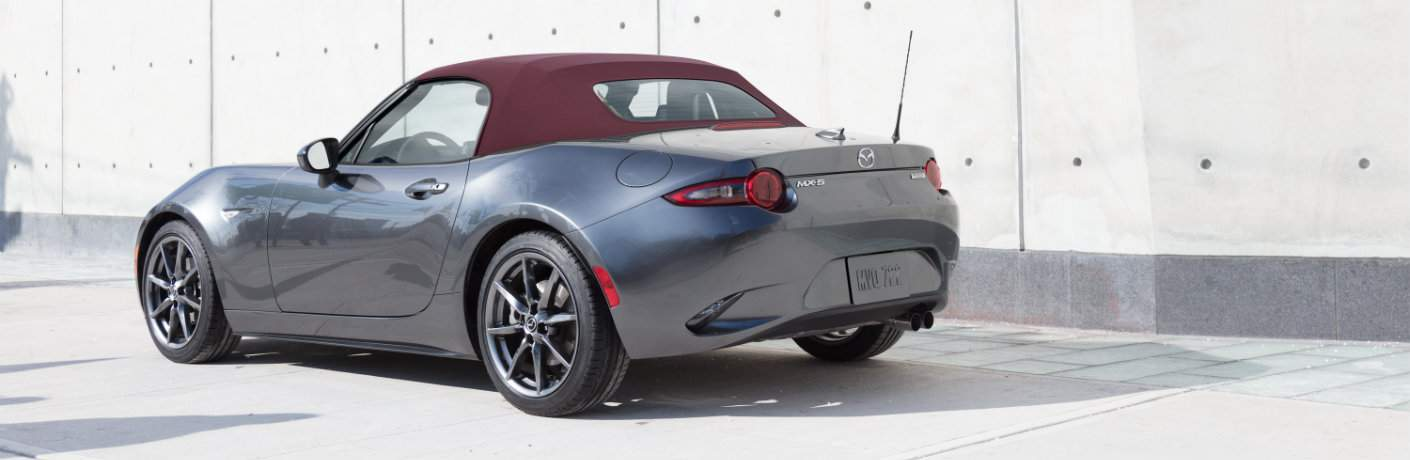 2018 Mazda MX-5 Miata gray with cherry red soft top back side view
