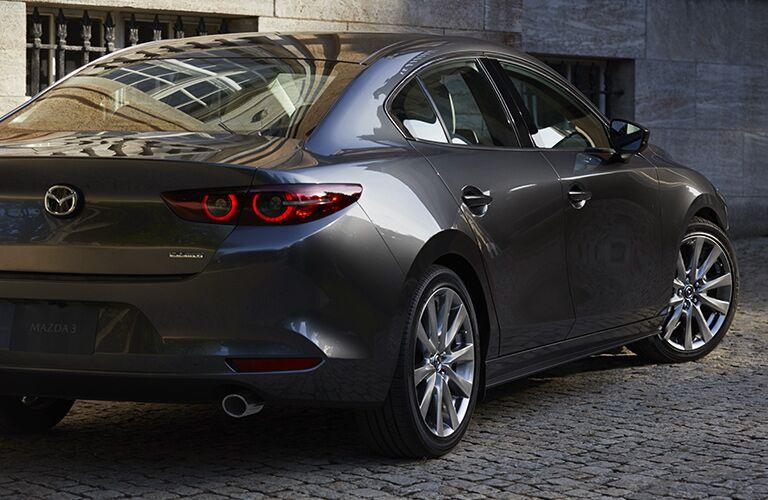 2019 Mazda3 Sedan gray back side view