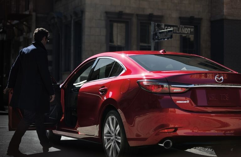 2019 Mazda6 red back view with man getting in