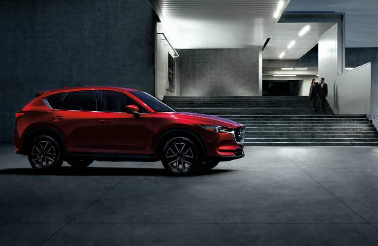 2017 Mazda CX-5 parked in front of a modern building