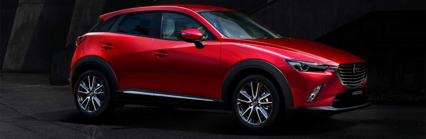 Profile shot of 2018 mazda cx-3 in red color against dark background