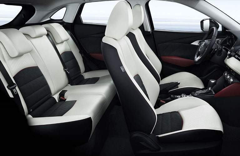 Front and rear seats in 2018 mazda cx-3 shown from profile cutaway
