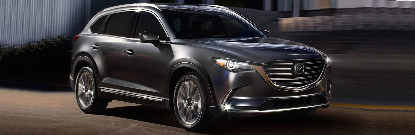 2018 Mazda CX-9 shown in dark gray graphite color at night parked on street near Wilson nc