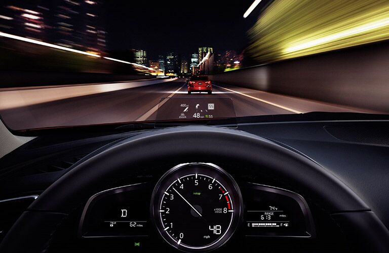 view from 2018 mazda3 driver's cockpit with heads up display