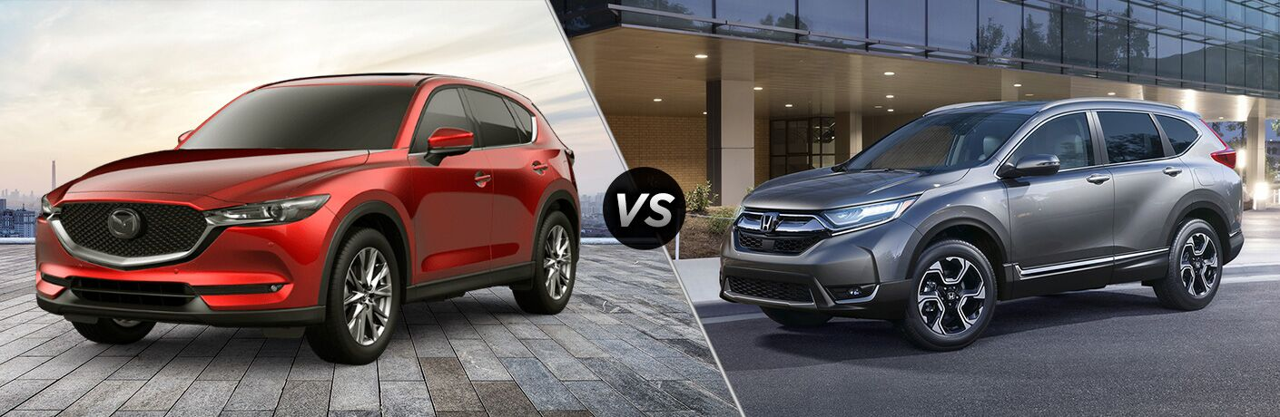 "Front driver side exterior view of a red 2019 Mazda CX-5 on the left ""vs"" front driver side exterior view of a gray 2019 Honda CR-V on the right"