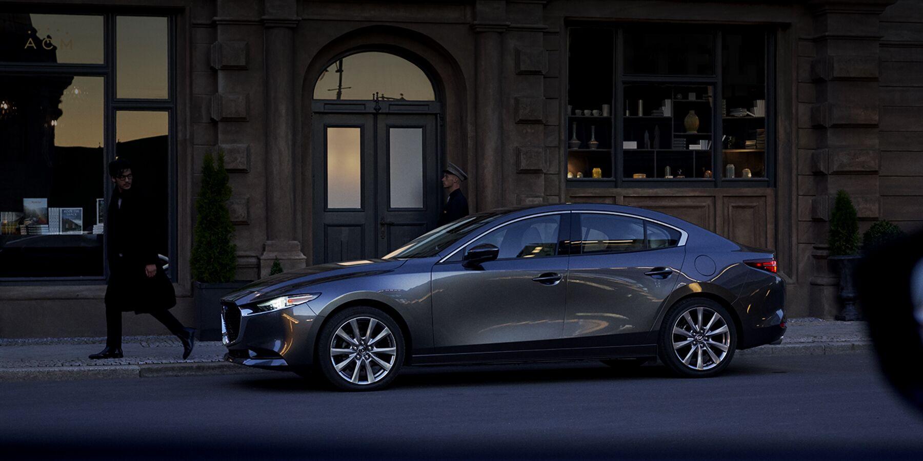 A 2019 Mazda3 sedan outside a house