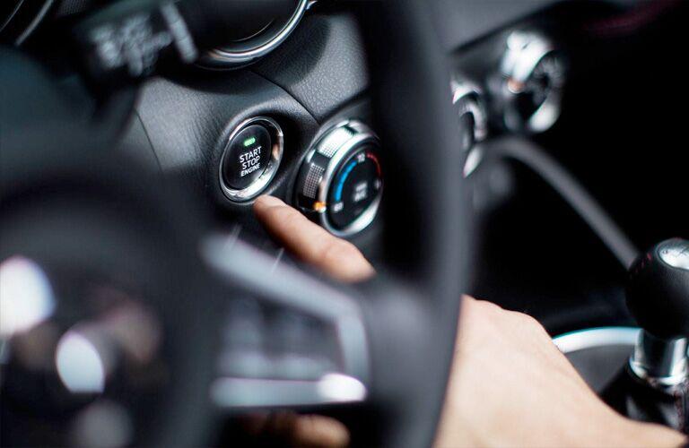 2019 Mazda MX-5 Miata with driver adjusting climate control