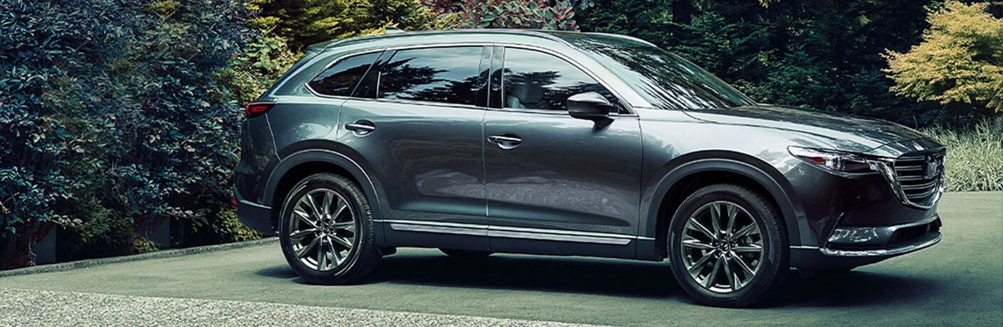 2020 Mazda CX-9 parked by hedge