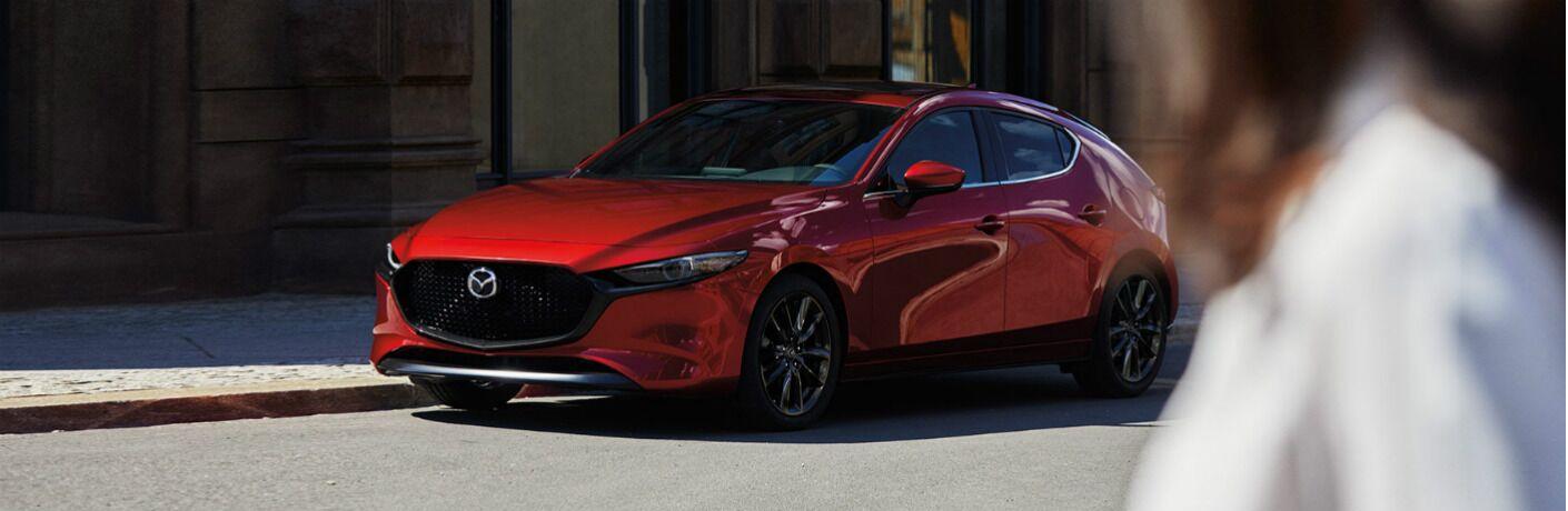 2020 Mazda3 hatch parked on city side street