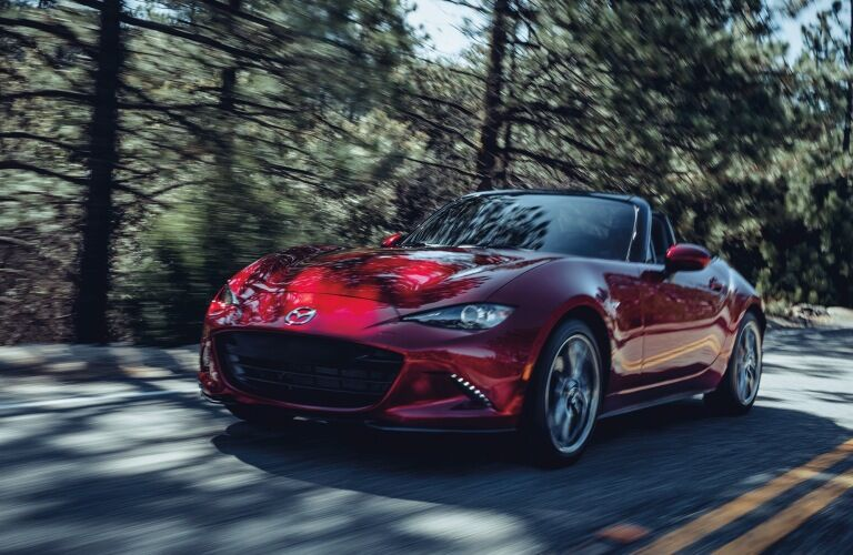 2020 Miata driving on tree-lined road