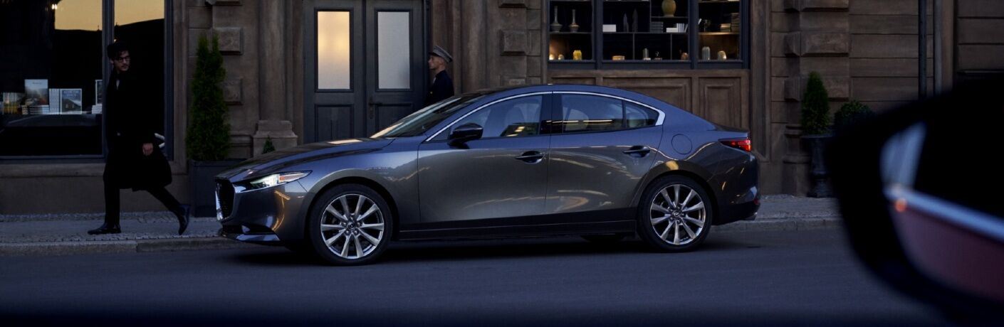 2021 Mazda3 parked in front of shop