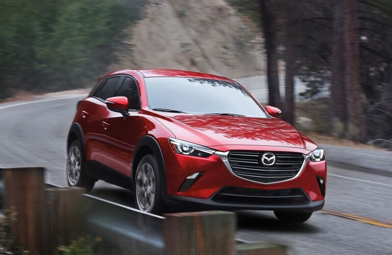 2021 CX-3 driving on mountain road