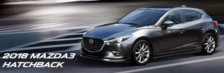 grey 2018 mazda3 hatchback with banner in bottom left corner