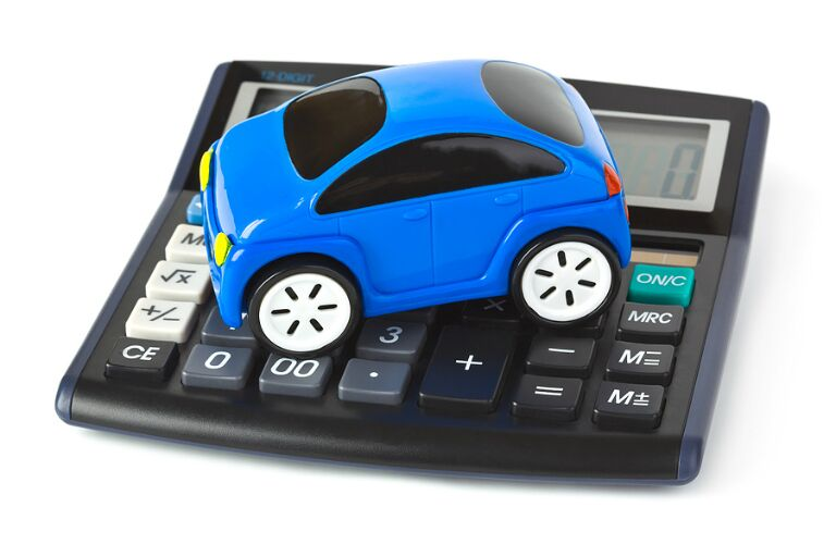 A blue toy car sits on a calculator, symbolizing great value.