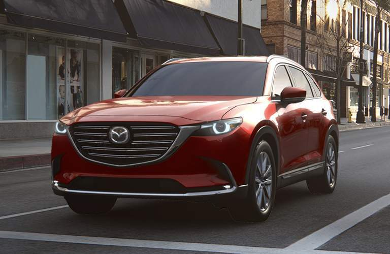 red mazda cx-9 in city