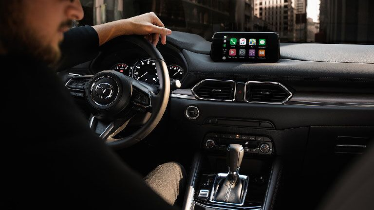 Interior view of someone driving the 2019 Mazda CX-5