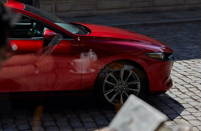 front end of red mazda3
