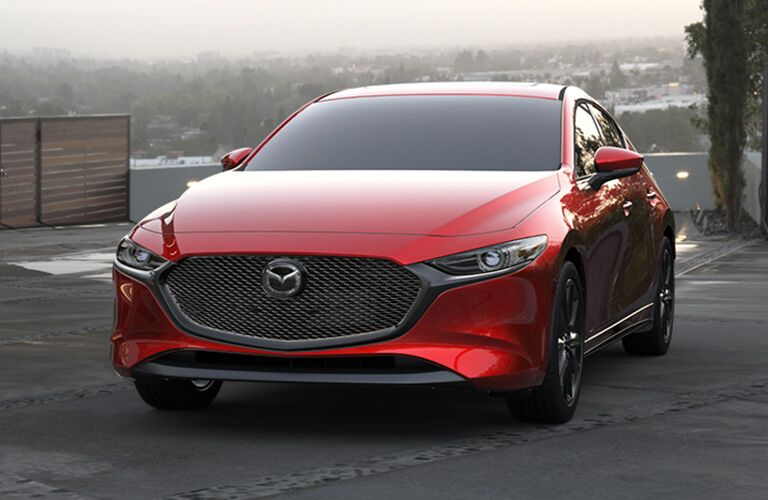 front view and grille of red mazda3