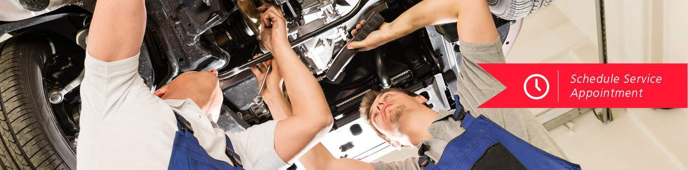two men working under car with schedule service icon
