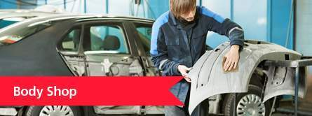 man holding damaged car part