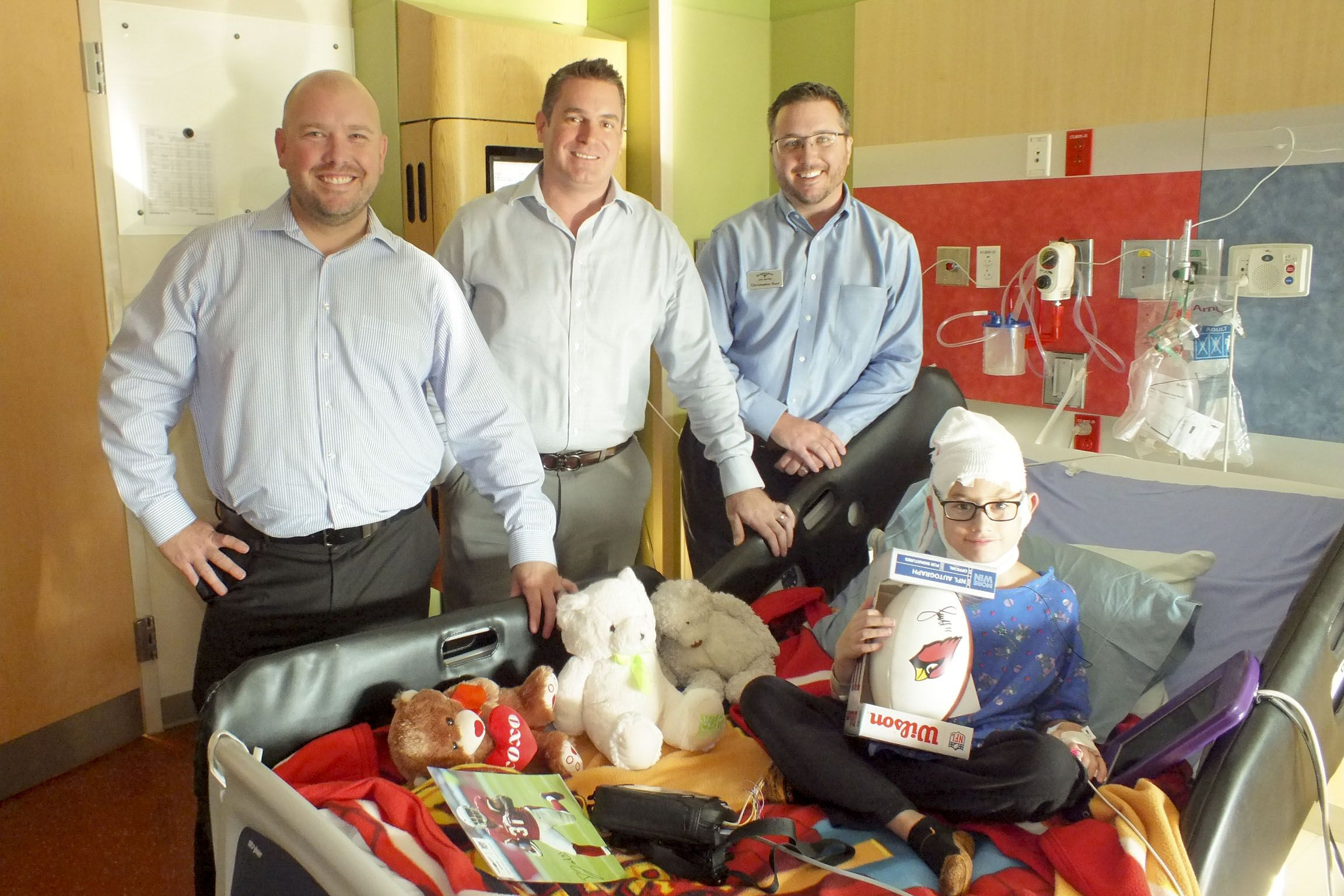 Adam (Earnhardt Hyundai GM), Peter (Rodeo Hyundai GM), and Chris (Marketing Director) at Phoenix Children's Hospital