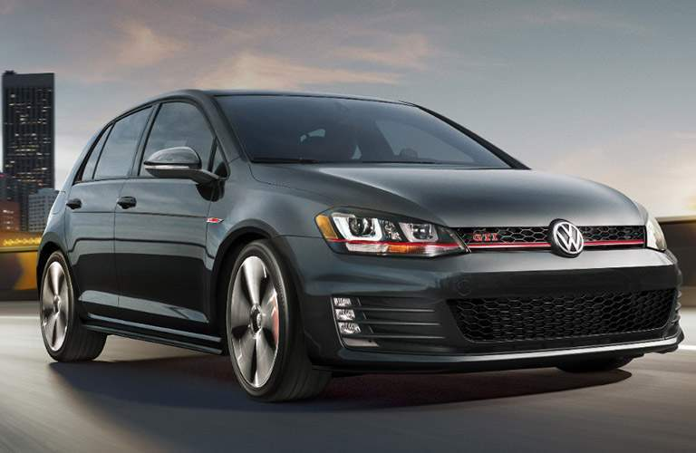 black volkswagen golf gti front, driving