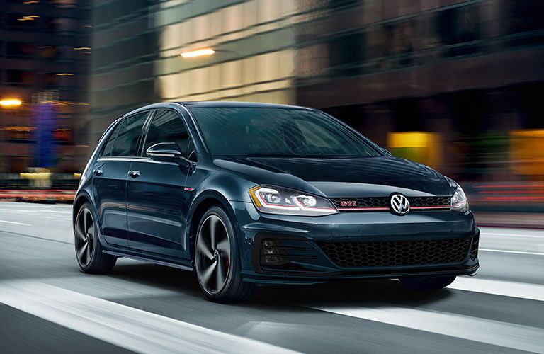 2020 VW Golf GTI driving in the city