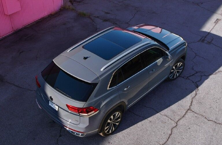 2020 Volkswagen Atlas Cross Sport exterior overhead shot parked in shade near a pink wall