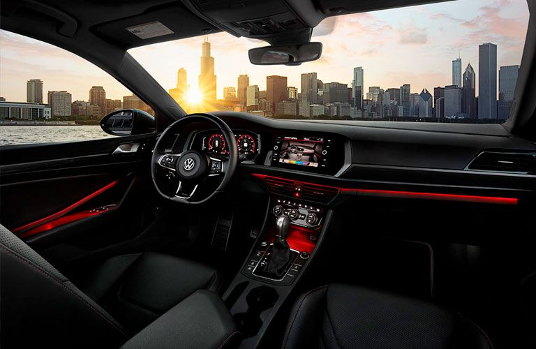 2020 Volkswagen Jetta GLI interior shot of black seating, red accents, and dashboard layout