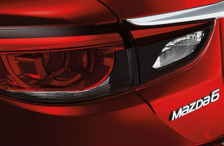 2017.5 Mazda6 Rear End View of Tailight with Mazda6 Emblem on Red Exterior