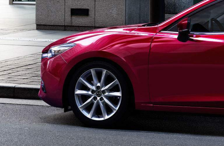 View of Side and Wheel of 2017 Mazda3 in Red