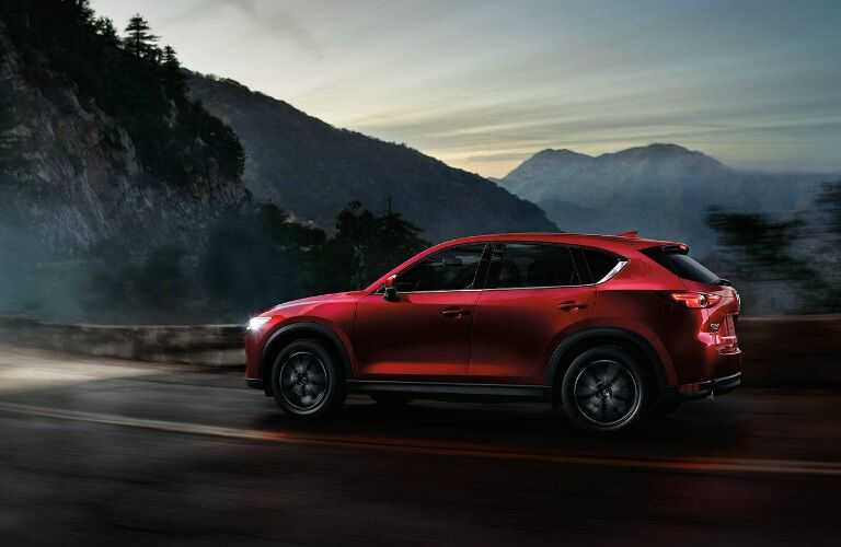 2018 Mazda CX-5 driving toward mountain at night