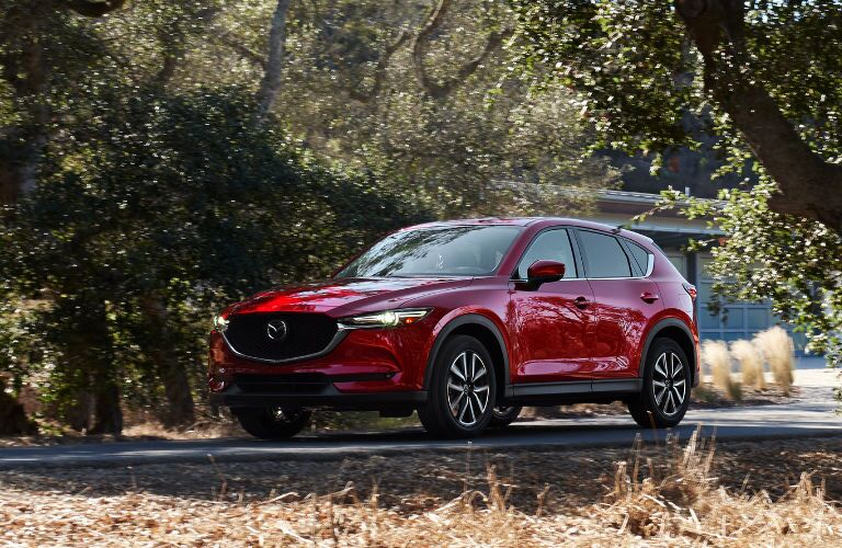 2018 Mazda CX-5 driving along grassy road