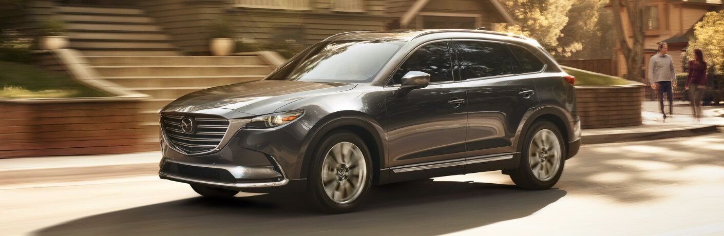 2018 Mazda CX-9 driving down residential street