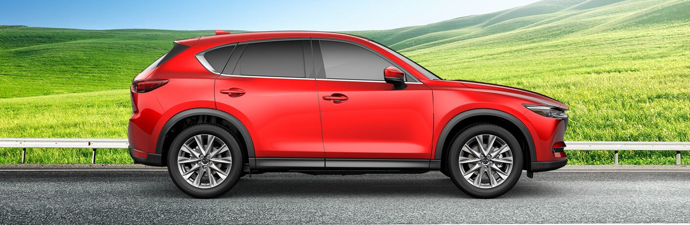 Red 2019 Mazda CX-5 Grand Touring Reserve Side Exterior on Country Road