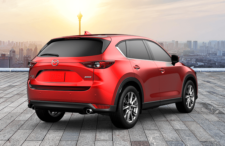 Red 2019 Mazda CX-5 Signature Rear Exterior in Front of City Skyline