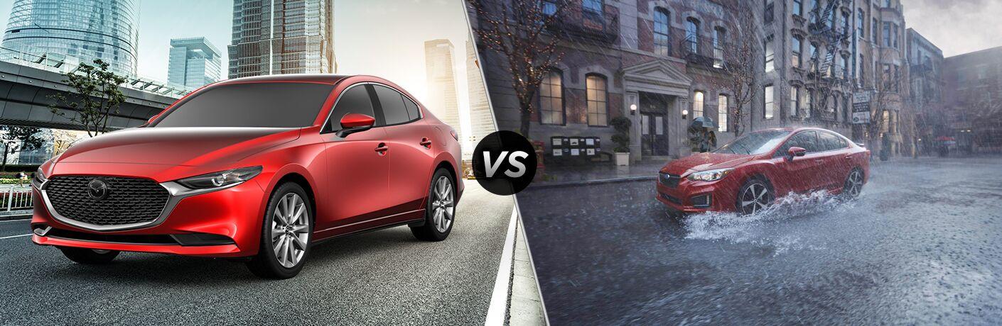 Red 2019 Mazda3 Sedan on a City Street vs Red 2019 Subaru Impreza in the Rain