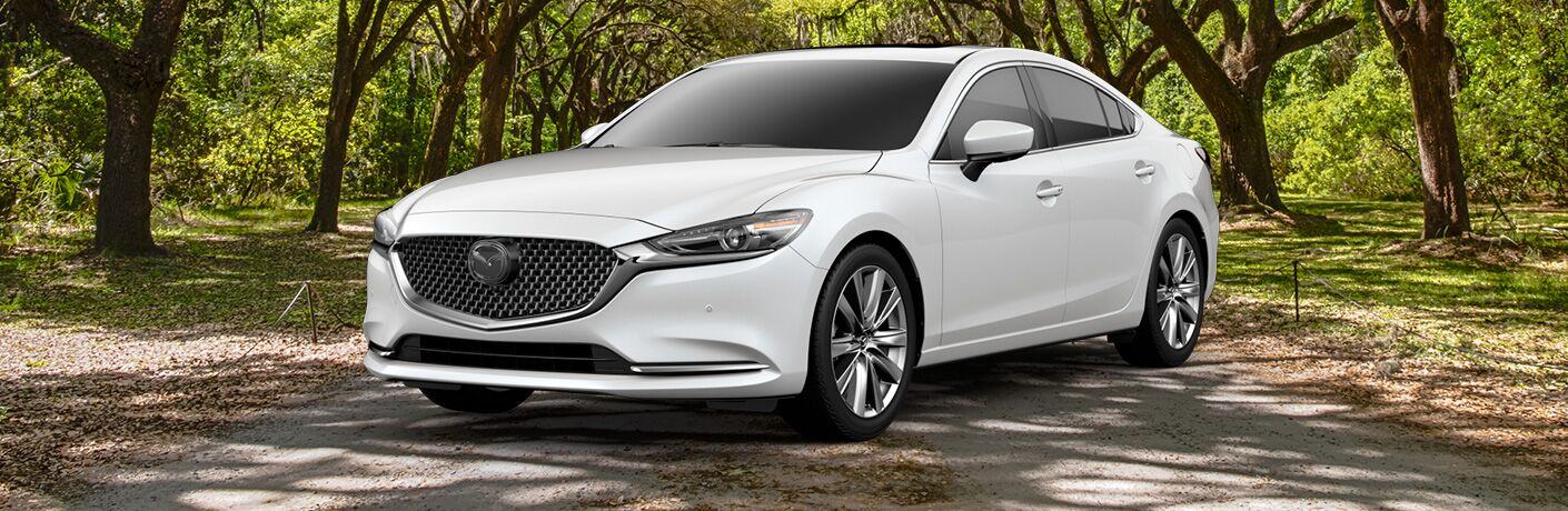 White 2019 Mazda6 Signature on a Country Road