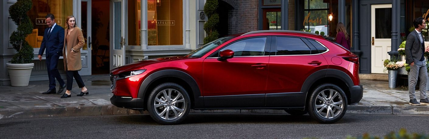2020 Mazda CX-30 on street side by storefront