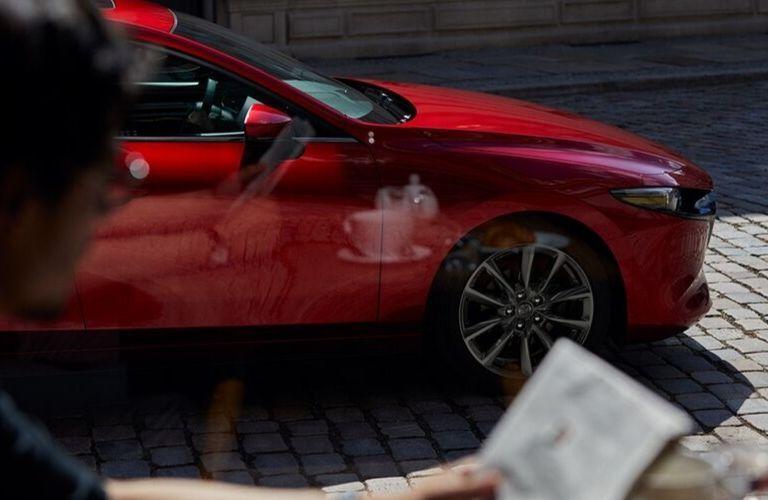 2020 Mazda3 Hatchback viewed through cafe window