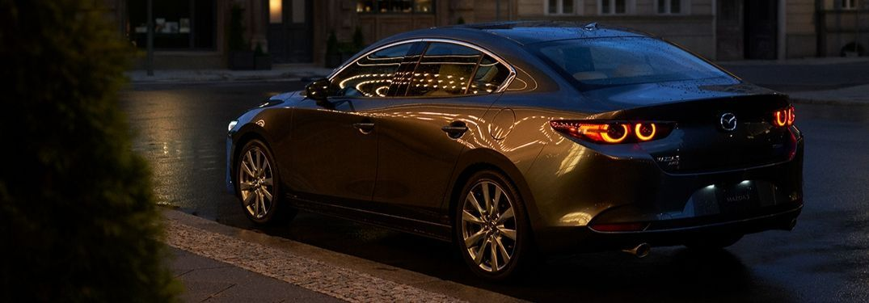 2020 Mazda3 parked on city street at night