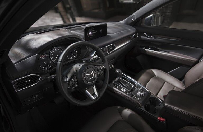 2021 Mazda CX-5 dashboard, front seats, and steering wheels