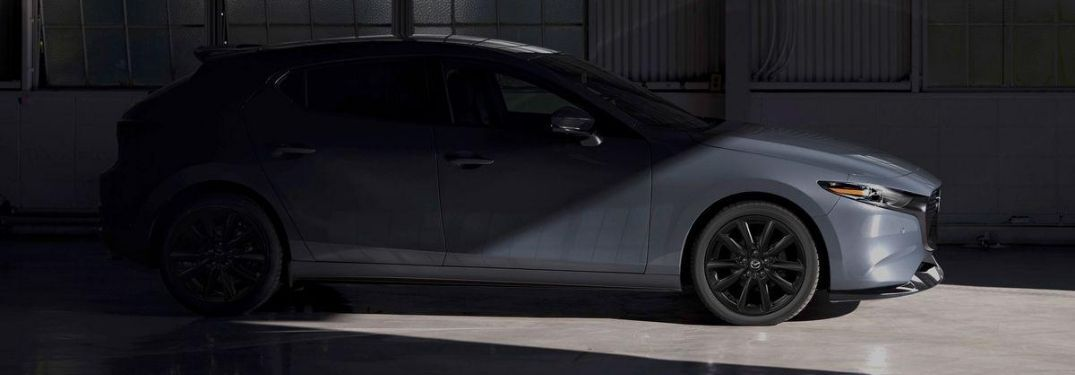 2021 Mazda3 hatchback concealed in shadows