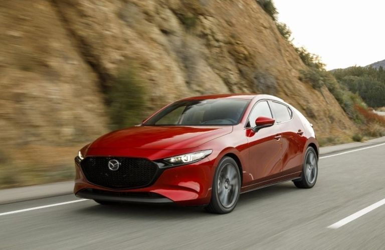 2021 Mazda3 hatchback on rural road