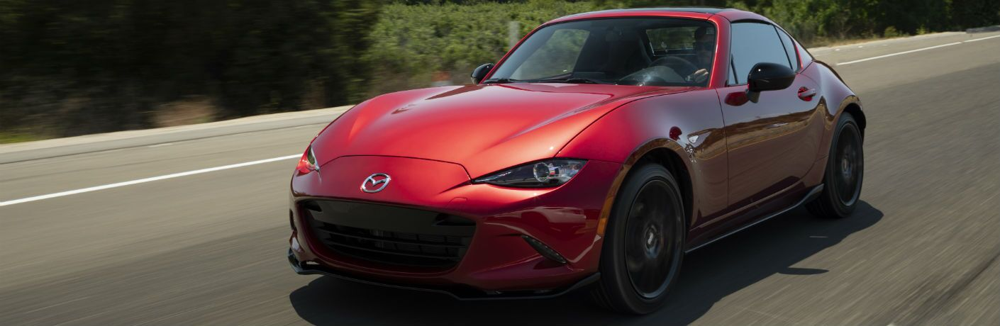 A front left quarter photo of the 2019 Mazda MX-5 Miata RF on the road.