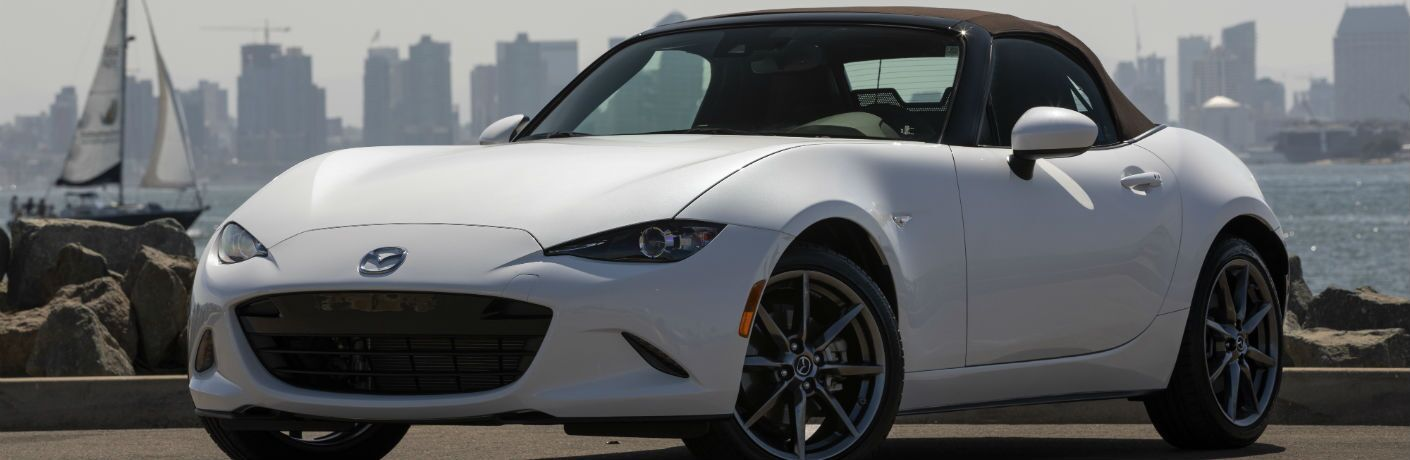 A front-right quarter photo of the 2019 Mazda MX-5 Miata with its soft top closed.
