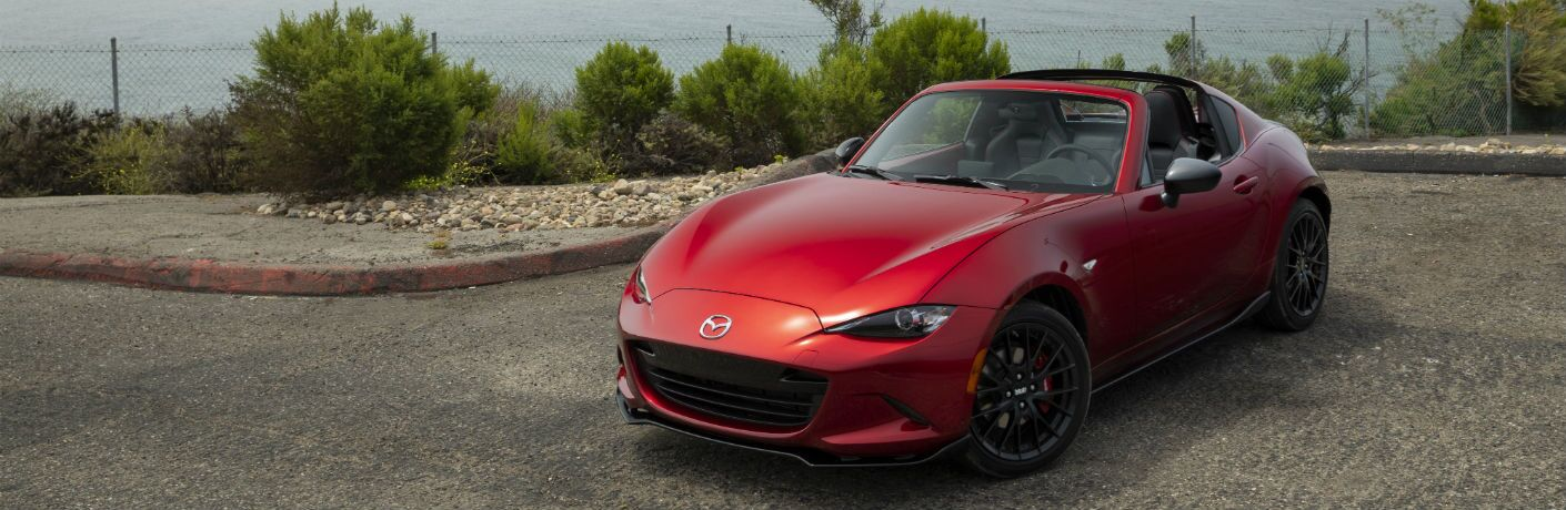 A photo of the 2019 Mazda MX-5 Miata RF with its roof open.